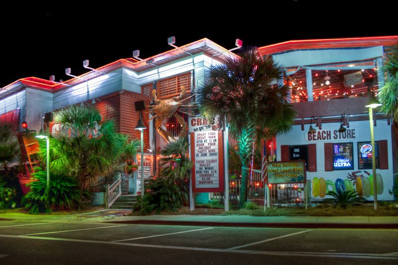 Crabs Is A Por Seafood Restaurant On Pensacola Beach Florida In The Shadow Of Their Water Tower Painted Like Ball