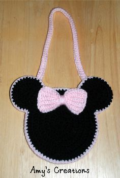 Crochet Minnie Mouse Purse My daughter loves Minnie Mouse so I made her this cute purse. Enjoy this Cute Minnie Mouse Purse Pattern! If you tell others about my work, please only link back to my blog, but don't copy my patterns to your site. Also you can sell anything you make from my patterns,