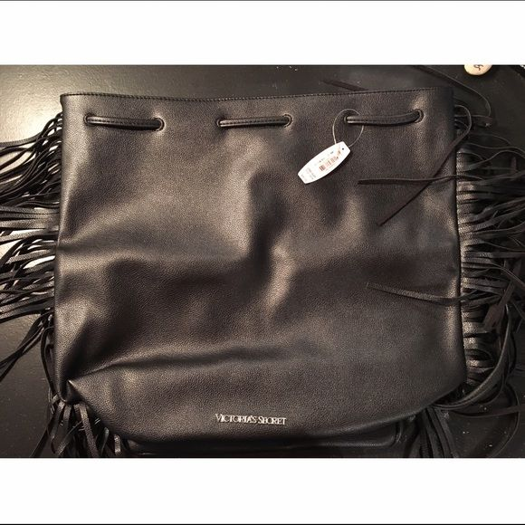 Black, fringe, drawstring Victoria's Secret bag Cute, modern Victoria's Secret bag! This is a black leather drawstring bag with plenty of space. Not my style but looking to get rid of this quick. I'm willing to negotiate/trade! :) Victoria's Secret Bags