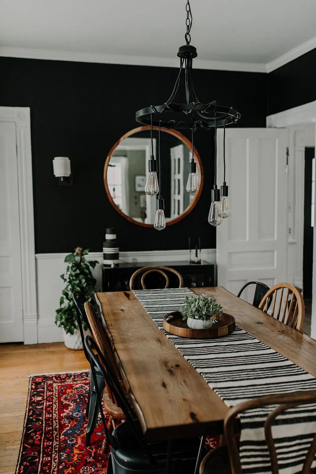 An Eclectic Dining Room with an Unconventional Wall Color