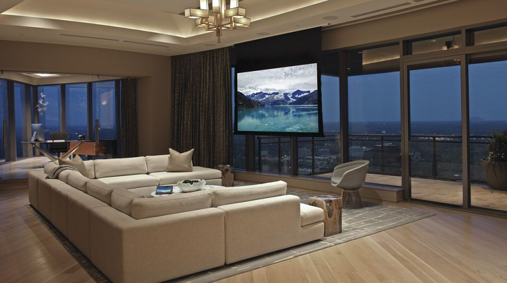 This Atlanta Penthouse Is Part Living Room Part Home Theater  Ce Impressive Living Room Home Theater Ideas Design Decoration