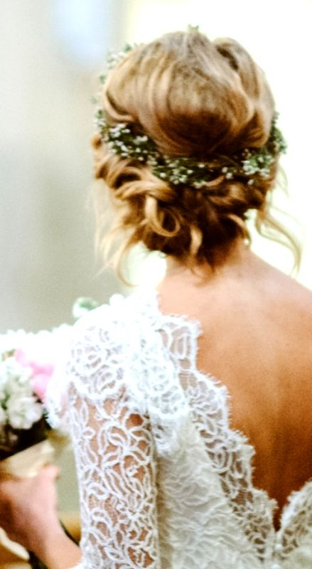 Twisted Low Bun With Flower Crown Wedding Hairstyles With Crown Best Wedding Hairstyles Wedding Hair Flowers