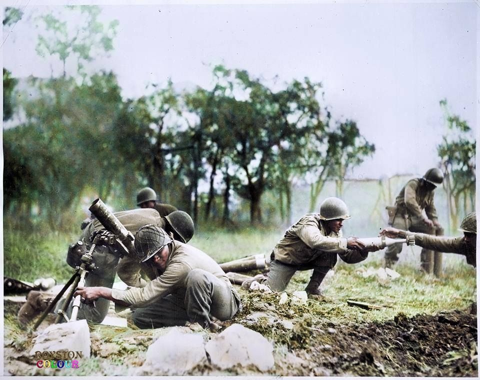 astrangerreplay:  The 92nd US Infantry Division, 5th Army (also known as the 'Buffalo Soldiers', an all African American division) firing mortars towards German positions in Massa, Italy, as some other members of the division pass ammunition towards the 81mm M1 Mortar.  November, 1944.