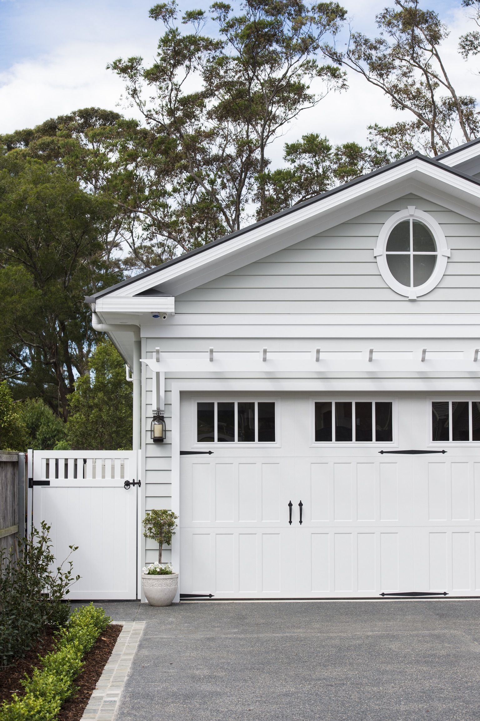 A neutral colour palette and scyon linea weatherboards are key for house rubansaba