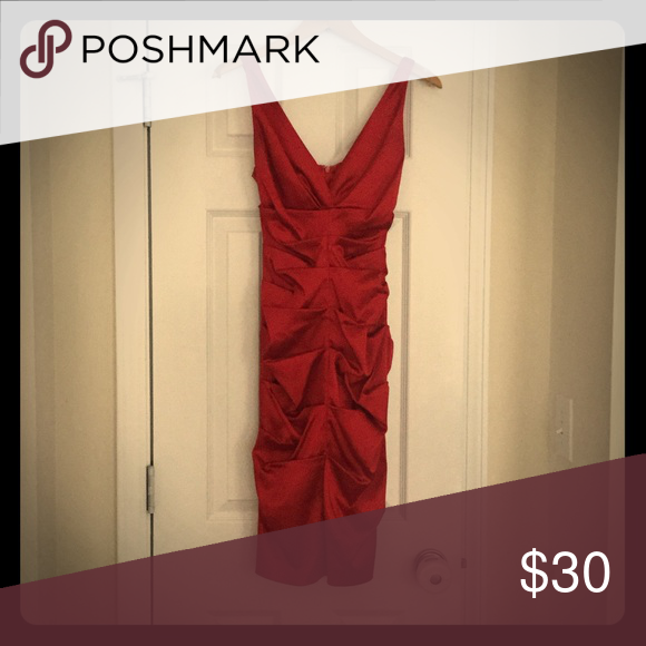 Red Dress Worn only a couple times! No stains or tears...it's a size 0 but since it's stretchy can fit up to a size 4 easily. Dresses