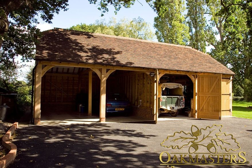 Hand crafted four bay oak framed garage with tiled roof