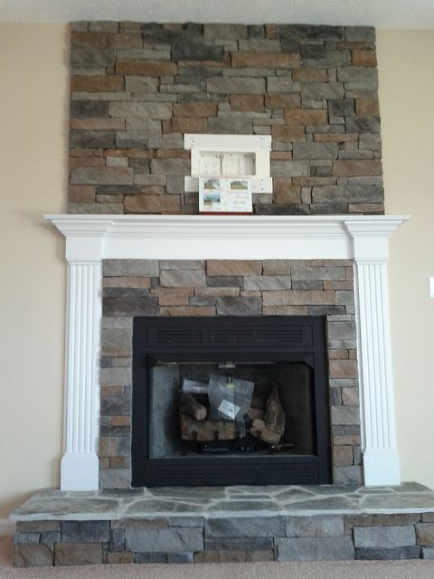 Stone work as an accent above the fire place (and cable/electrical ...