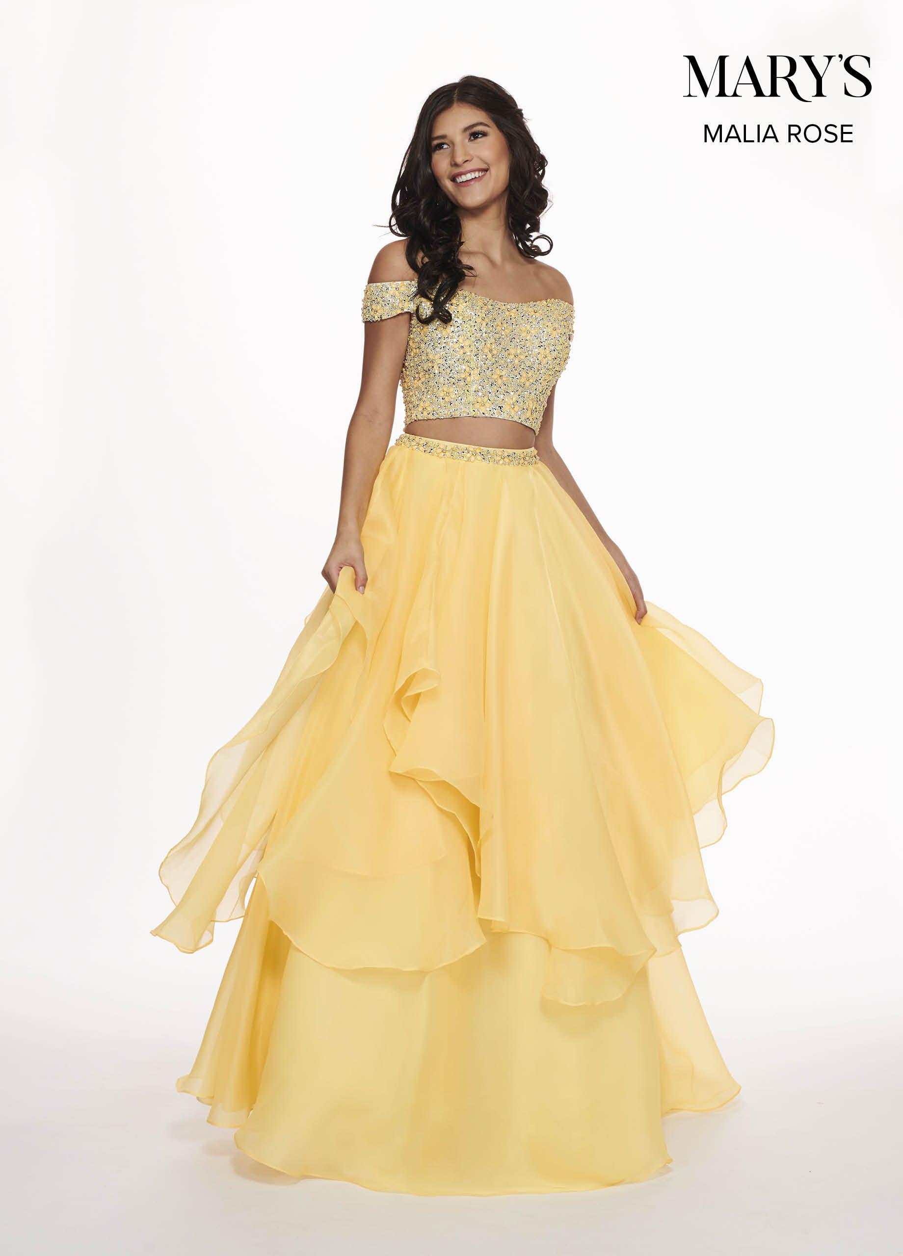 d45702b1f70 2-piece crop top prom dress features off-the-shoulder beaded top and organza  tiered skirt with beaded waistband.