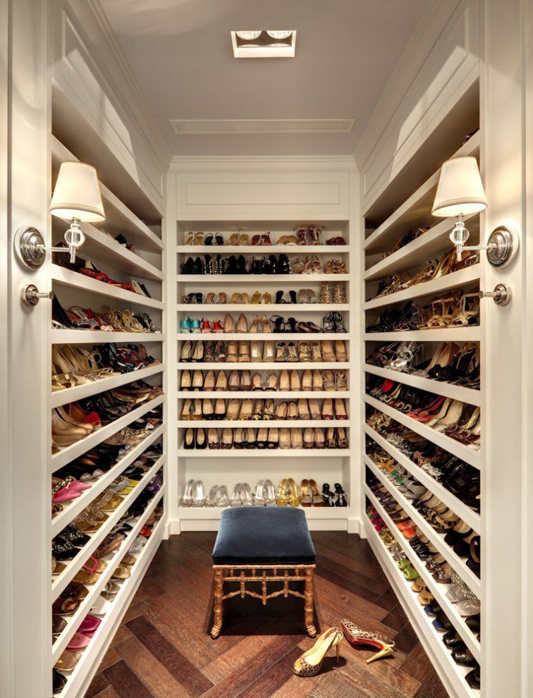 amazing closet dedicated to just shoes walkin shoe closet features floor to ceiling shelves for shoes accented with robert abbey muse sconces as well as