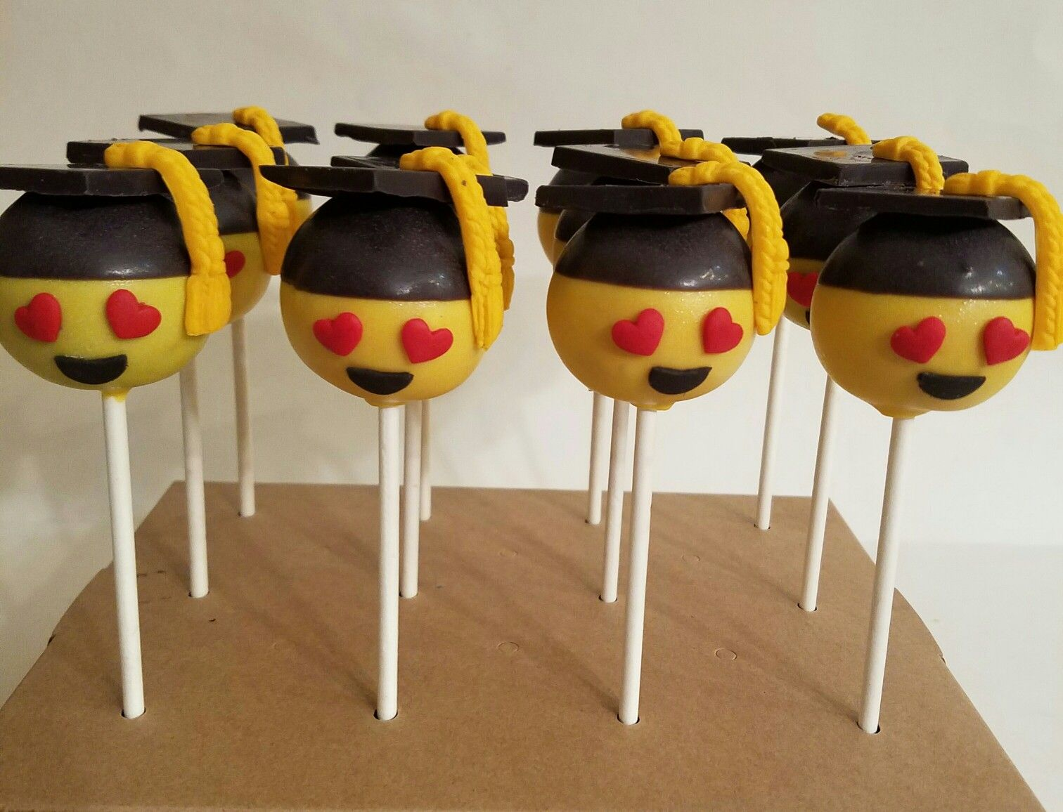Emoji cake popsgraduation emoji cake pops cake pops