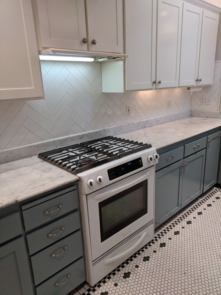 White Long Subway Tiles Set In Herringbone Pattern With Light Grey