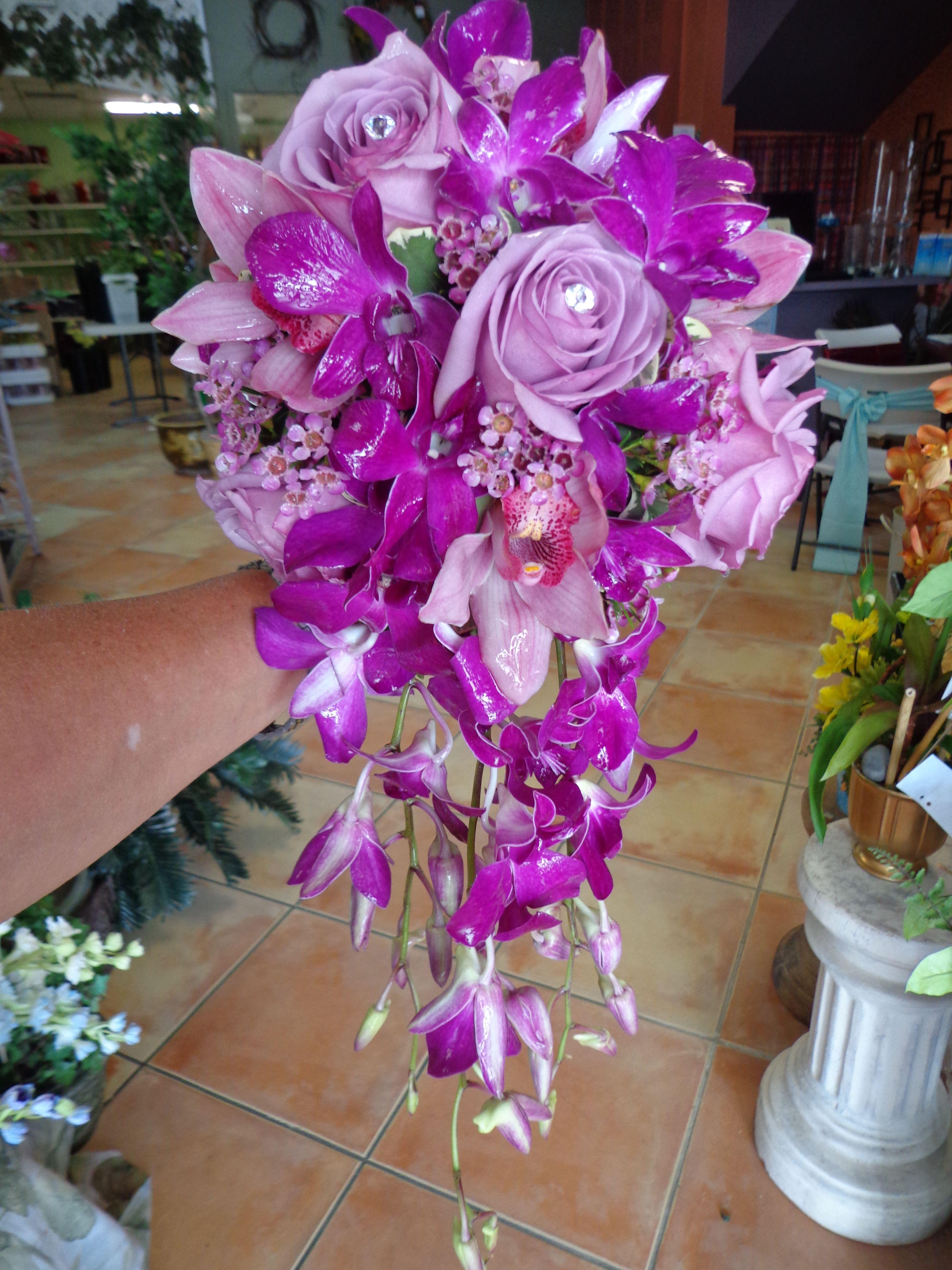 Cascading bridal bouquet of lavender Roses, mauve Cymbidium Orchids, and  purple Dendrobium Orchids. | Wedding flowers, Cascading bridal bouquets,  Bridal bouquet