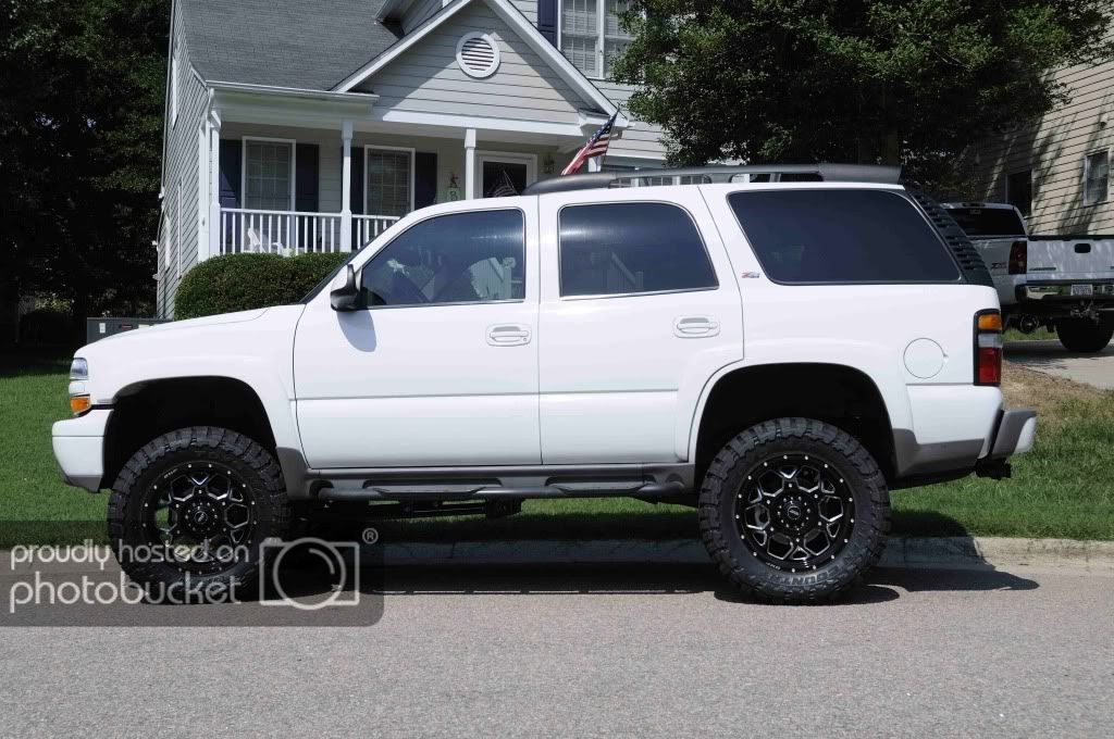 Lifted Tahoe Z71 White With Black Rims In 2005 Tahoe Z71 Lifted Lifted Tahoe Chevy Tahoe Z71 Chevy Tahoe