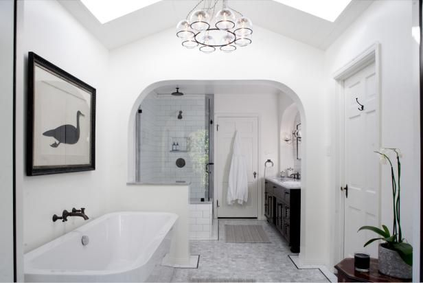 Elegant White Master Bathroom With Relaxing Soaking Tub