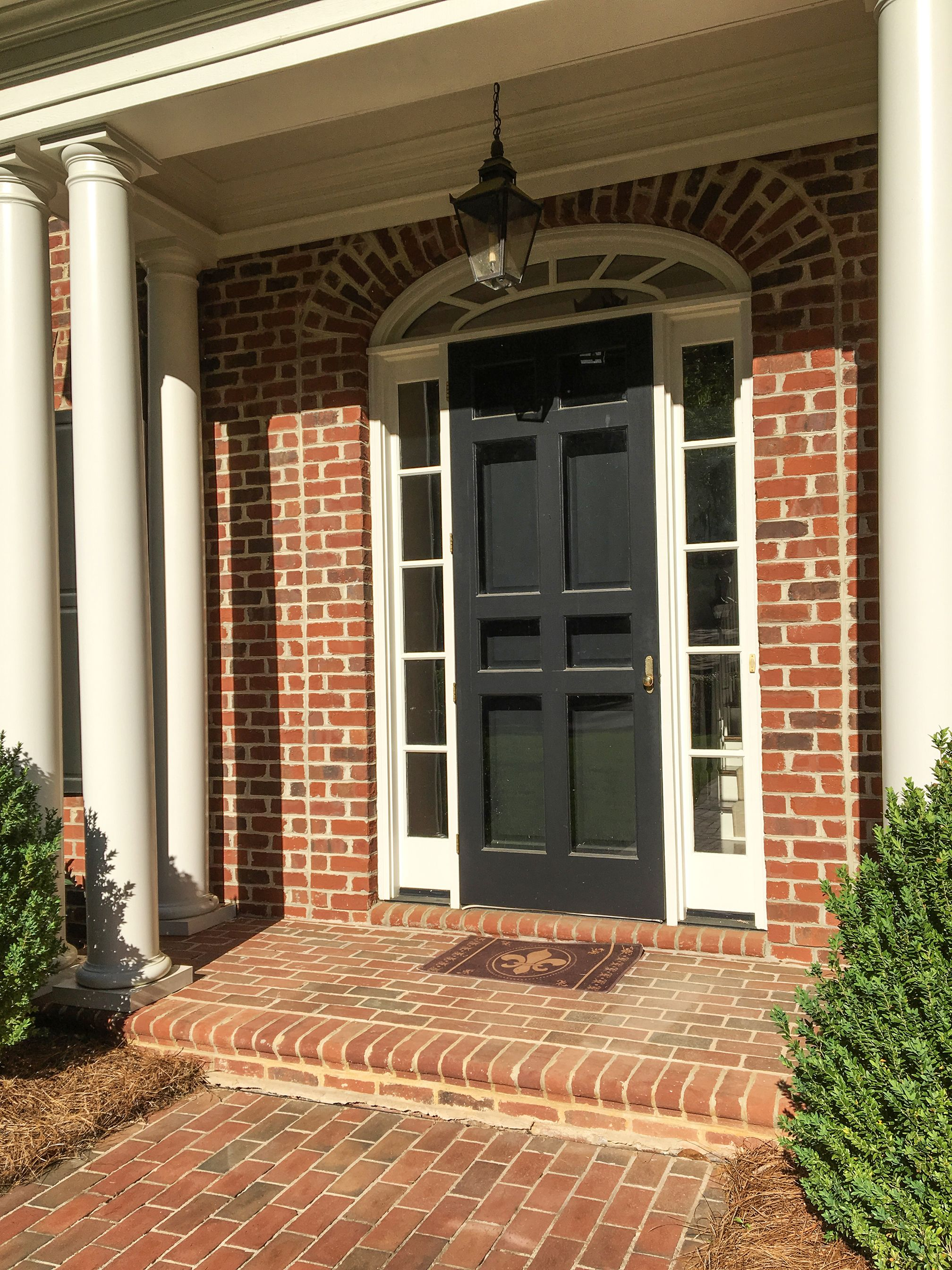 Arched lunar doorway for the perfect brick Greek Revival home.