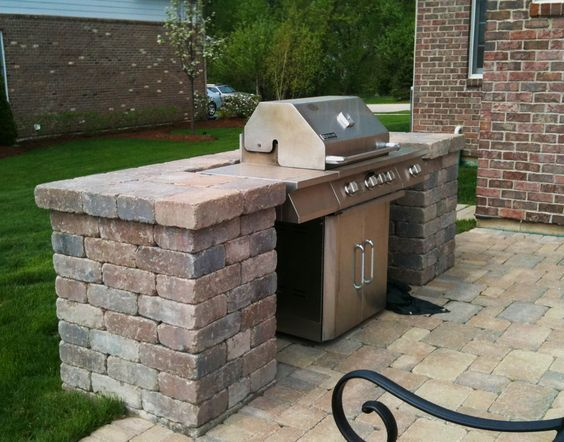 Belgard patio with built in grill surround by hawthorn for Outdoor barbecue grill designs
