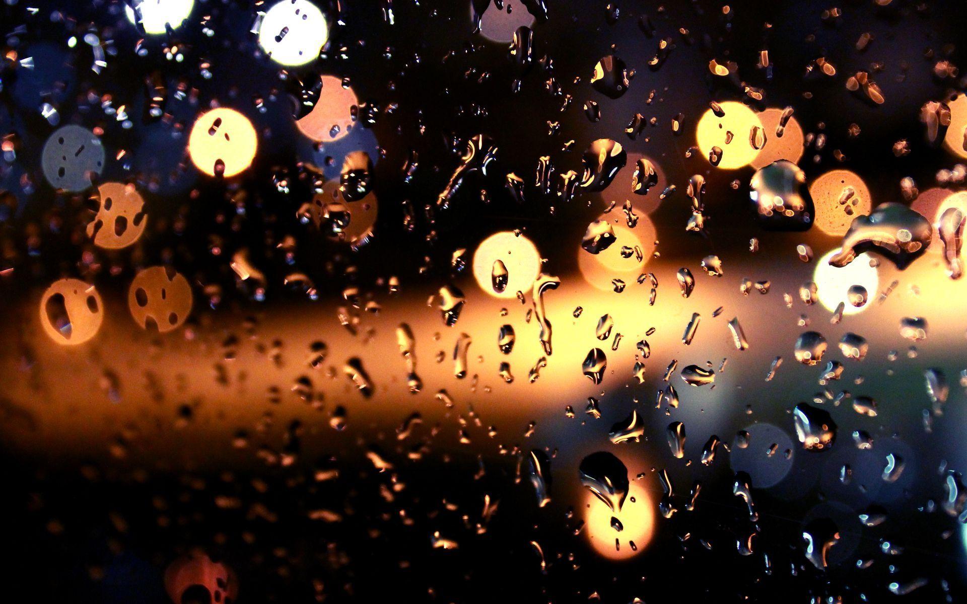 Rain Drops On The Window Wallpaper Bokeh Wallpaper Background Hd Wallpaper Lit Wallpaper