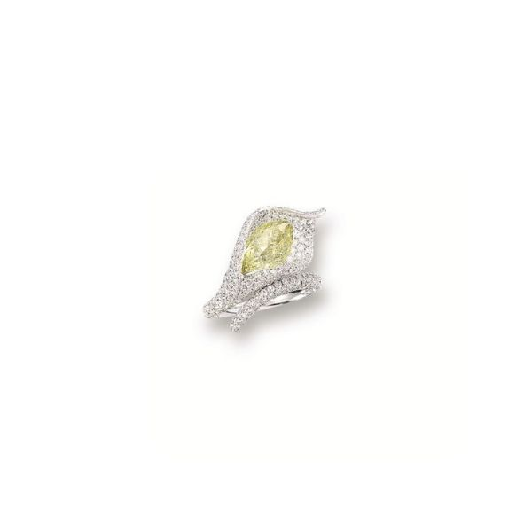 COLOURED DIAMOND AND DIAMOND 'FLORAL' RING. Modelled as a calla lily, set with a briolette diamond of yellow hue weighing approximately 4.05 carats, pavé-set with circular-cut diamonds together weighing approximately 1.65 carats, mounted in 18 karat white gold. by wteresa