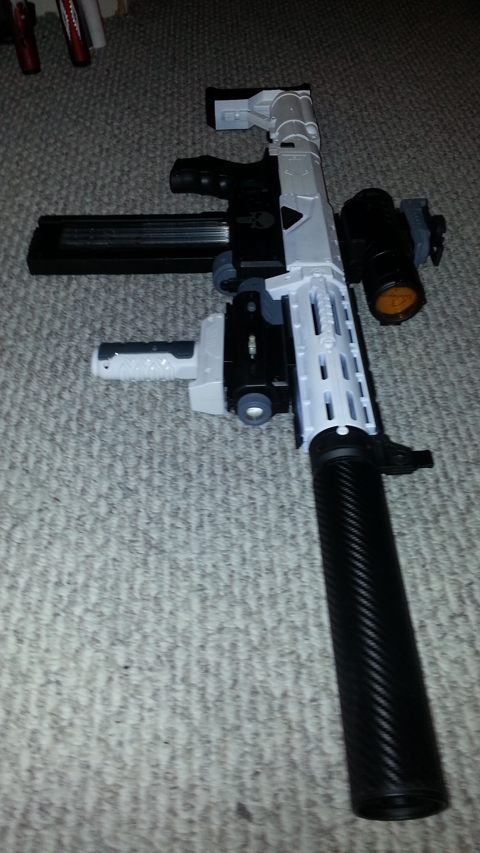 This is my custom Nerf recon with a stock laser sight & grip attachment & a