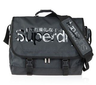 Superdry Pop Tarp Laptop Bag -- Superdry is known for its quality products, with strong and bold logo branding. With the Superdry Pop Tarp laptop bag you get all the functionality of a messenger type, courier bag in a modern fashion brand style. Features include a padded inner sleeve suitable for laptops up to seventeen inch screen size, several internal compartments, and a fully adjustable over-the-shoulder strap. Available in five colour designs.