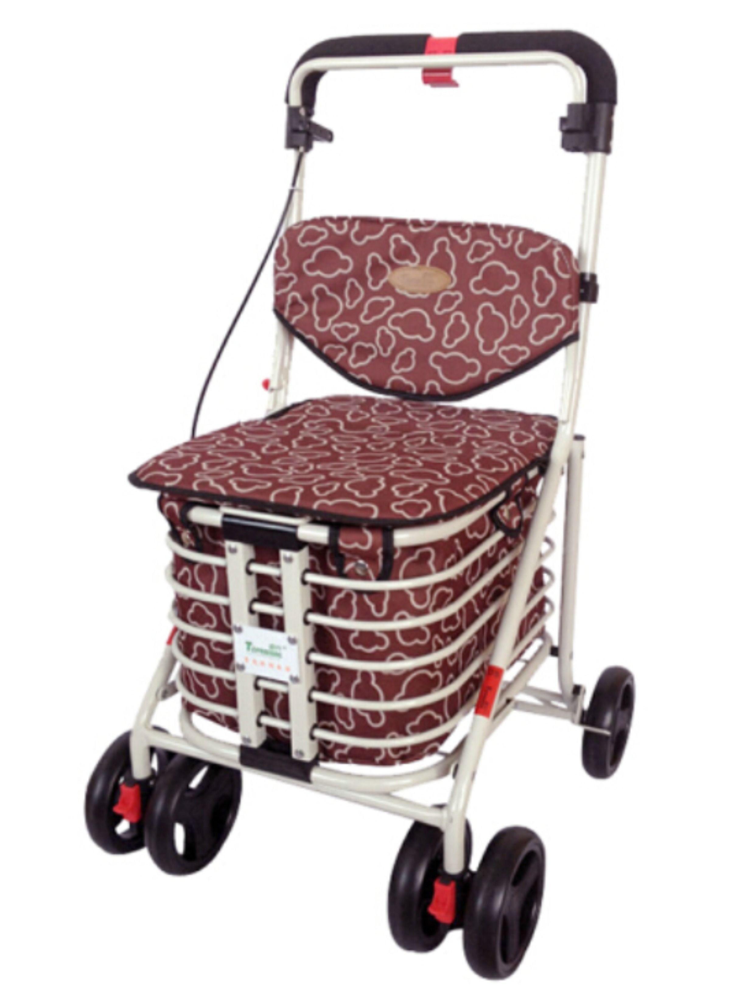 Elderly lady pushing a wheeled shopping trolley at shops