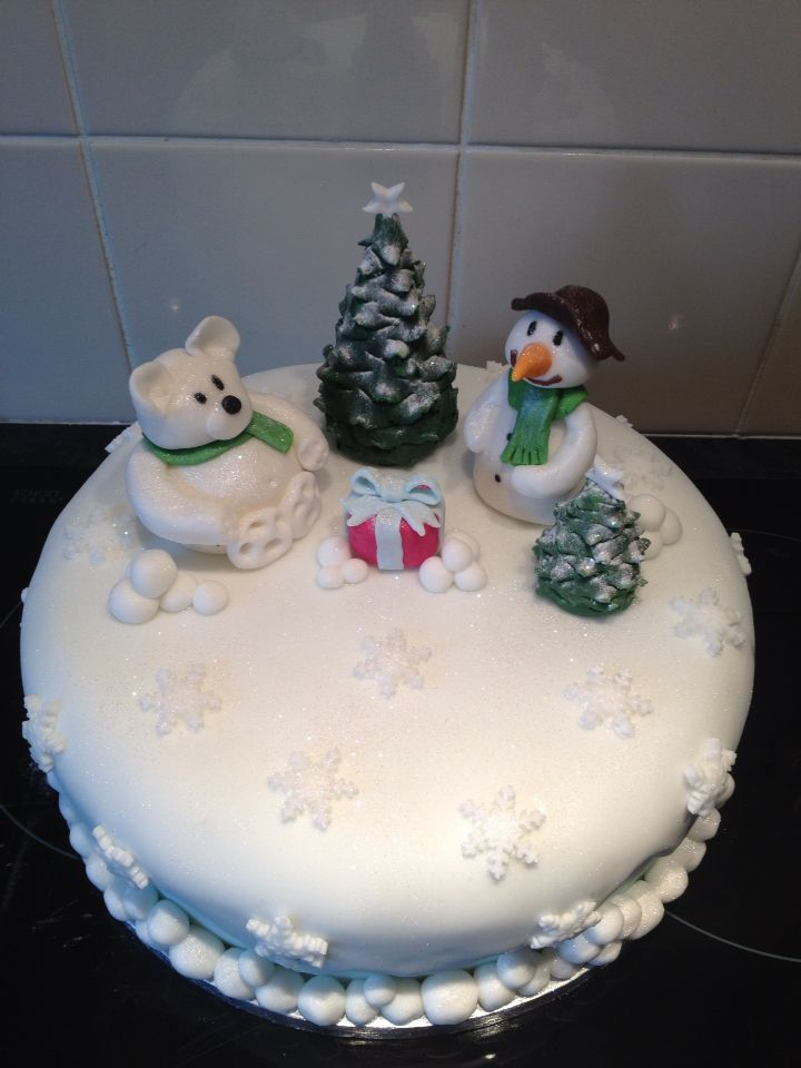 Christmas cake with snowman, polar bear, tree and presents
