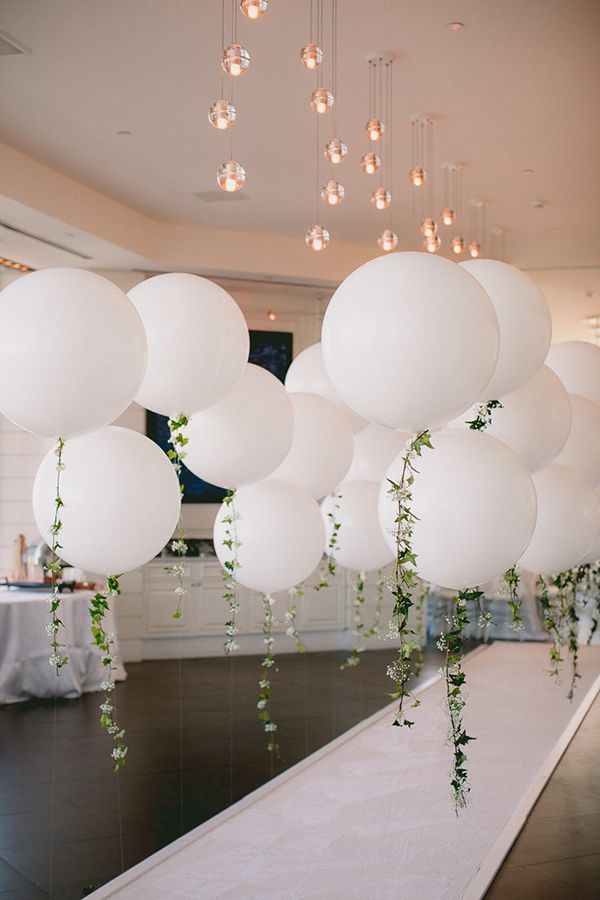 Diy balloon garland engagement party white balloons for Balloon decoration ideas for weddings