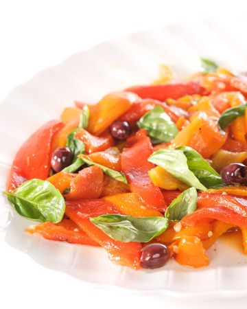A rainbow of smoky roasted bell peppers gets the Mediterranean treatment with a garlicky, caper-kissed vinaigrette and a scattering of Nicoise olives and fresh basil leaves.