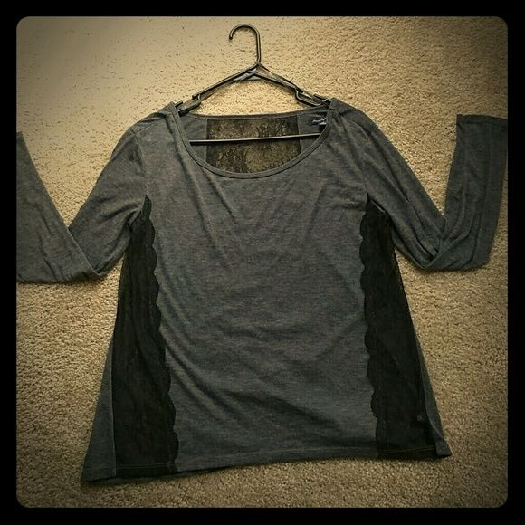 American eagle top! Grey American eagle top there is black lace on the sides and down the back, it is in great condition no stains(: American Eagle Outfitters Tops