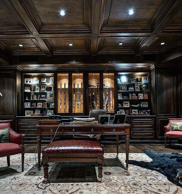 Incredible luxury dark brown wood gun room with office for Home gun room
