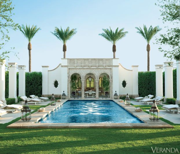 """FACADE POOL Exotic and Modern Desert House: Spanish and Moroccan traditions inspired Hallberg to create this exotic and modern American desert home. """"We didn't want something as opulent as a palace in Spain,"""" says Hallberg, """"so we pared things down, refining the plans until the house looked beautiful in its simplicity."""""""