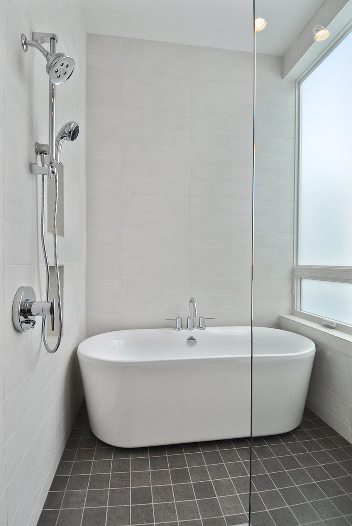 Complete Your Charming Bathroom With Freestanding Tubs Ideas: White Freestanding  Tubs On Dark Floor Matched With White Wall And Faucet Shower Plus Frameless  ...