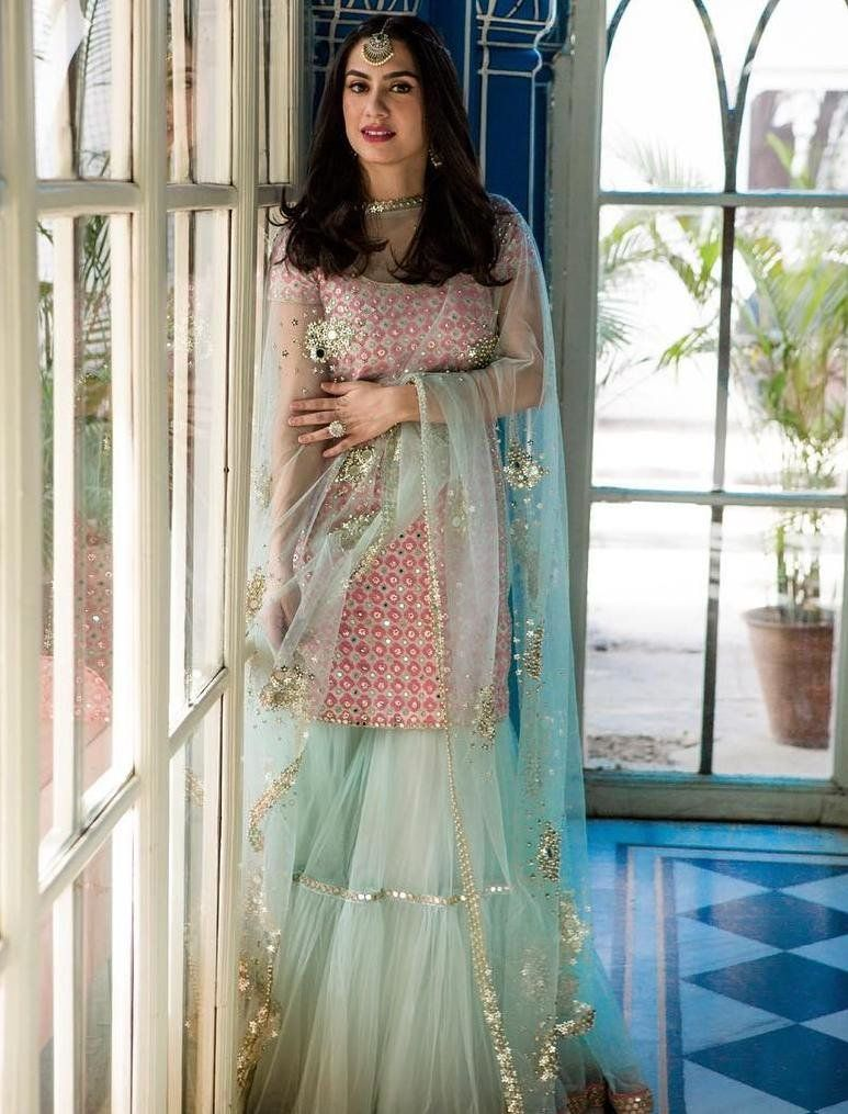 6650288f0f Doesn't she look super stunning in this pink and blue sharara set?  #weddinglook #desicouture#indiancouture #indiandesigner #pink#brid