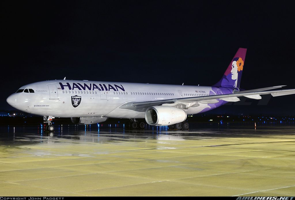 """Hawaiian Airlines Airbus A330-243 N378HA """"Kaukamalama"""" on a wet apron at Nashville-International, November 2015. This is one of three Hawaiian A330s that have an Oakland Raiders decal, celebrating the carrier's role as the NFL team's official airline since 2000. (Photo: John Padgett)"""