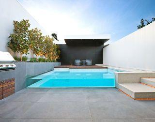 Modern swimming pool designed with bluestone