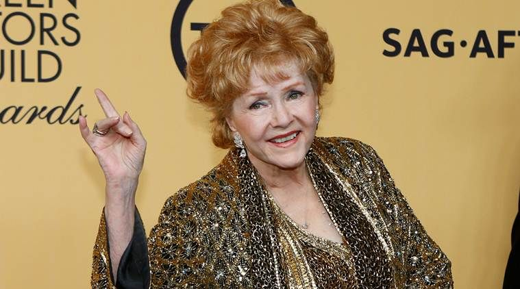 Carrie Fisher and Debbie Reynolds pose at the 21st Annual Screen Actors Guild Awards in 2015. (Photo: Steve Granitz/WireImage)