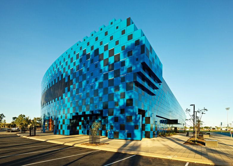 This black and blue sports centre in Western Australia was designed as a pixellated cluster of chunky cubes.