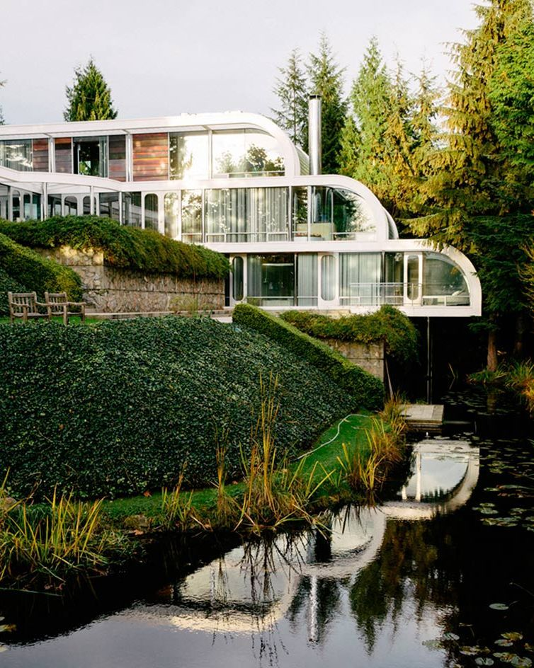 Eppich House Has Curved Lines And Is Located On A Slope Right Above The  Water To