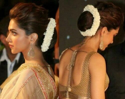 Deepika Padukone With Hair Bun And Flowers Indian Bridal Hairstyles Womens Hairstyles Indian Hairstyles