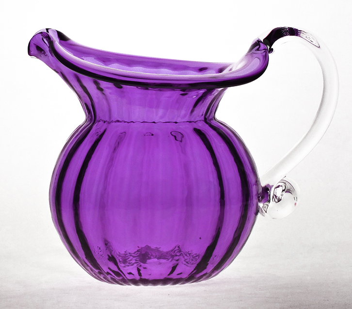 Low jug, with a crystal handle. Can be used to serve water or juice. Approximately 6 inches tall.Item Number: 1509-PURShipping, returns, and general information.