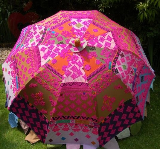 A Pretty, Brightly Coloured Parasol Is A Good Way To Brighten Up Your Garden  Should