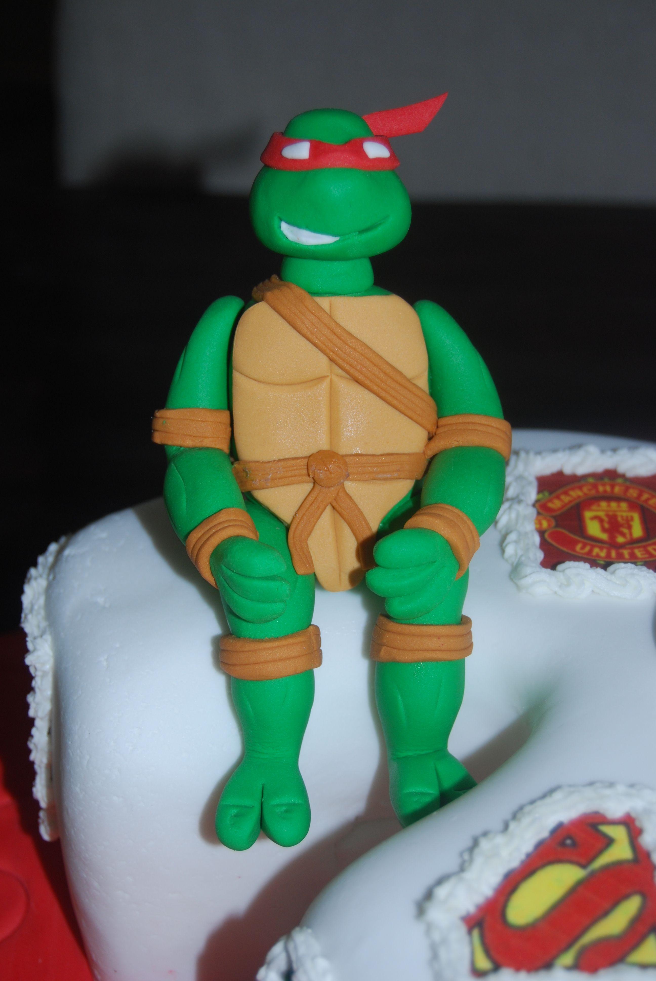 Raphael of the Ninja Turtles sitting on a 3rd Birthday cake