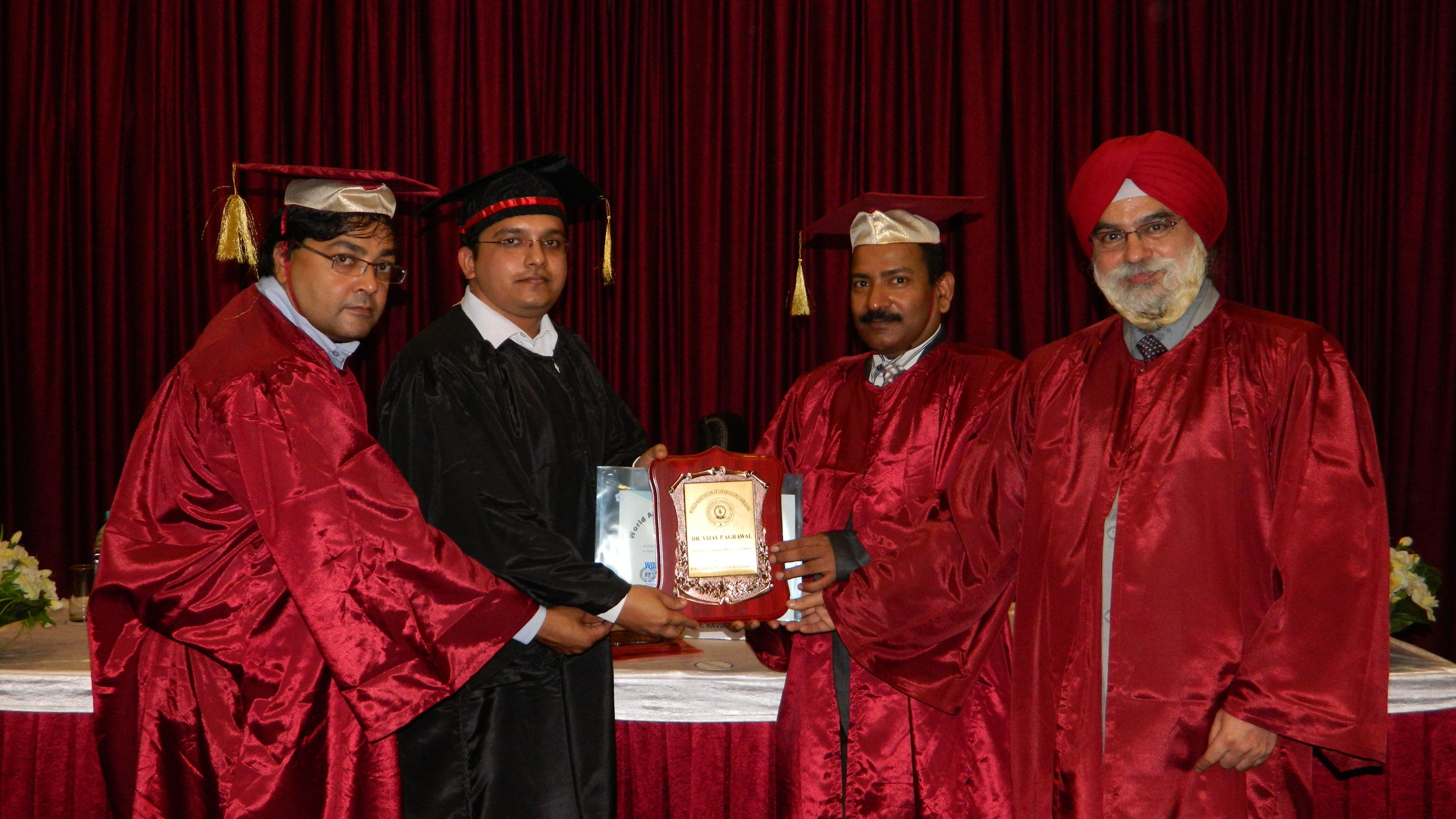 Dr. Vijay P Agrawal receiving certificate of Fellowship in minimal access Surgery at World Laparoscopy Hospital. For more detail please log on to www.laparoscopyhospital.com