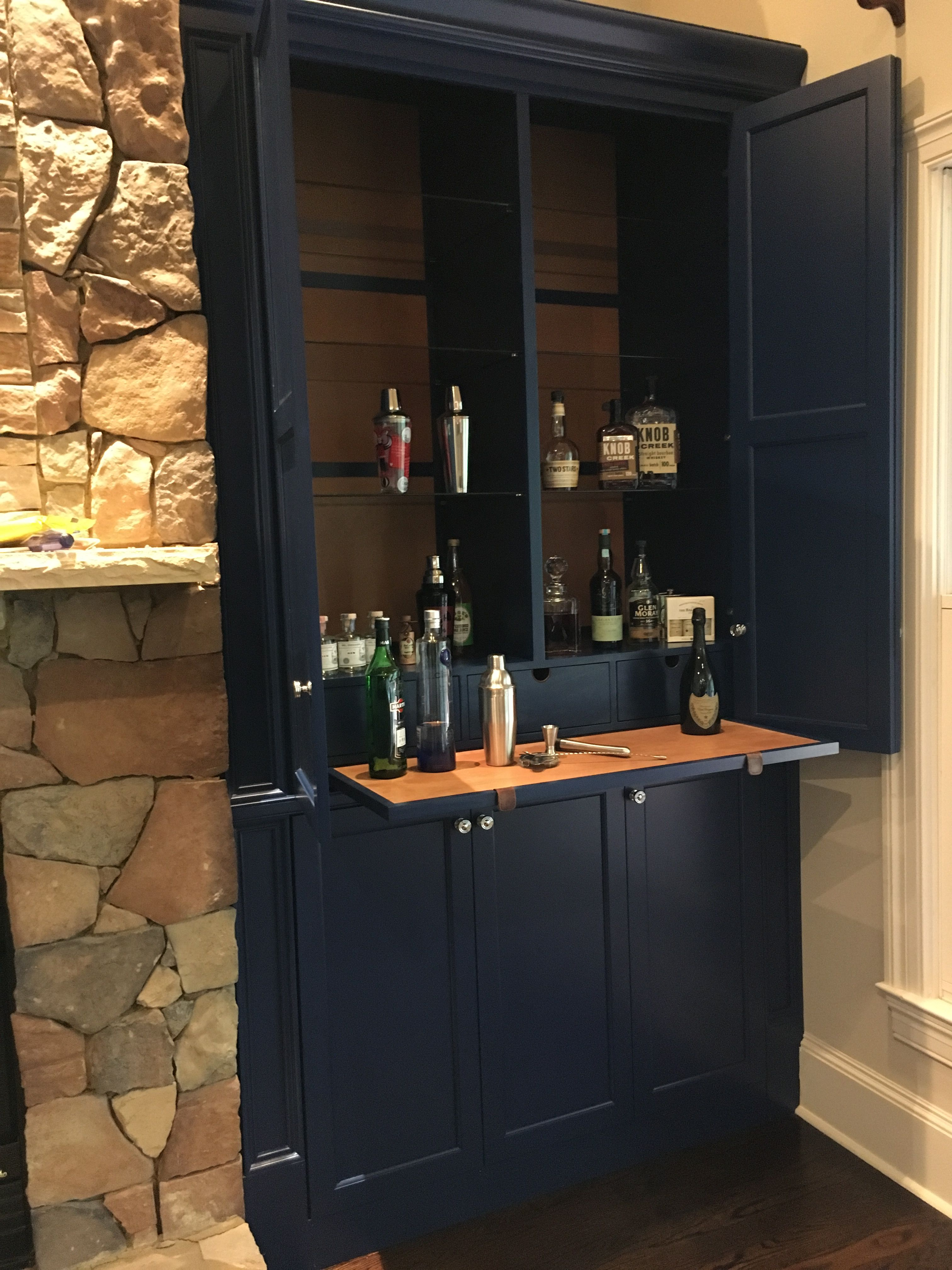 Dry Bar In Cabinet Next To Fireplace Complete With Leather