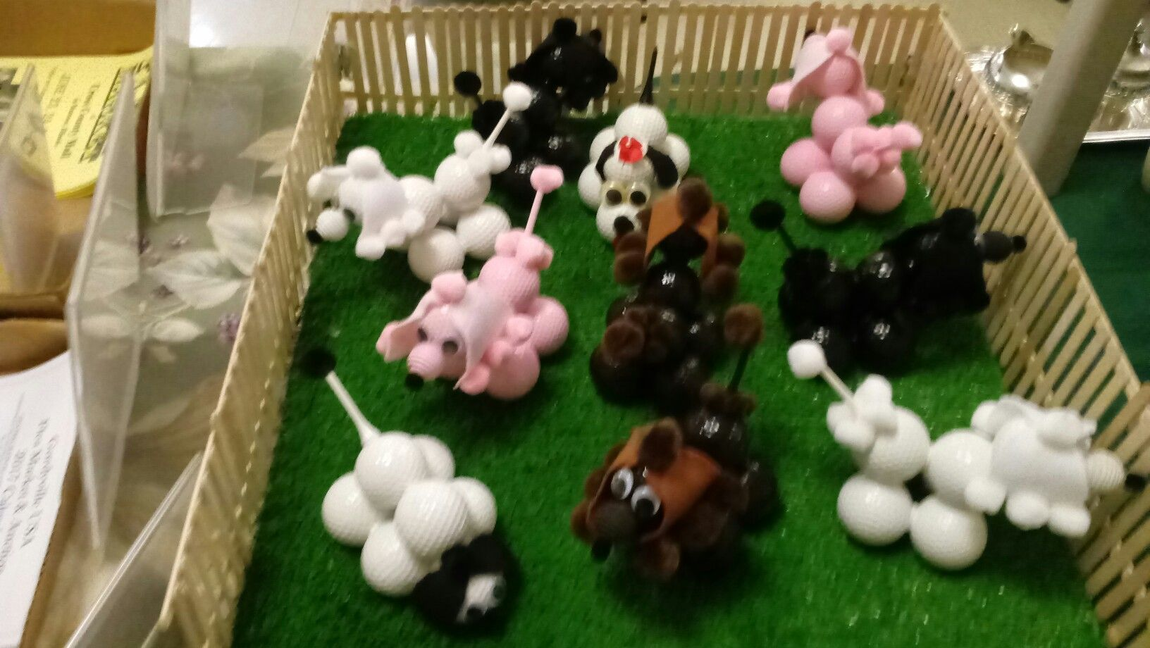 this is my dog park of golf ball poodles ,made of golf ball,mini pom pom ,paint,golf tees,hot glue.they sell for $10.00 each or three for $25.00 plus shipping if interested email me @  edward.west805@gmail.com
