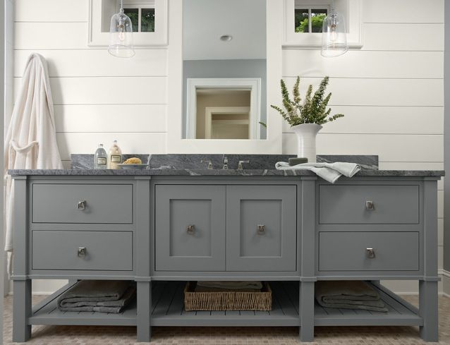master bathroom vanity in white/gold accents, concrete tile