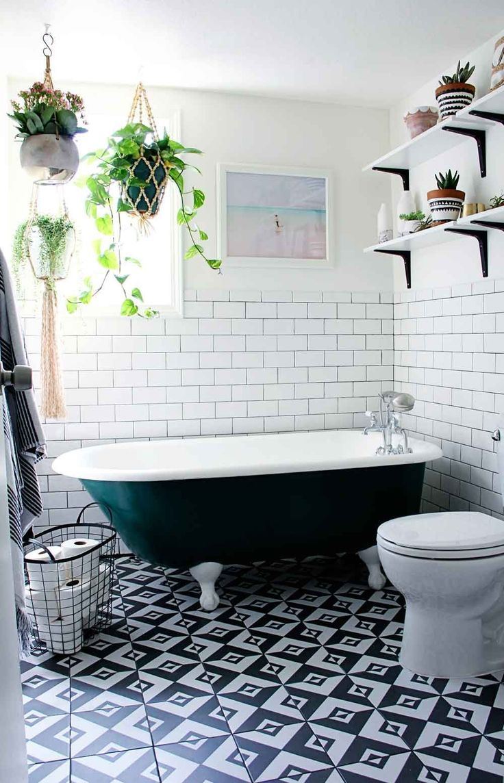 Gorgeous Black And White Tiled Bathroom With A Painted Clawfoot Bathtub