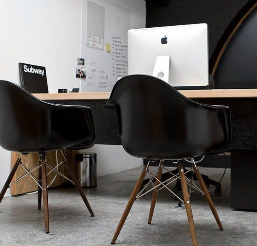 Eames Molded Plastic Armchair In Black With Chrome Base And Walnut Dowel  Legs