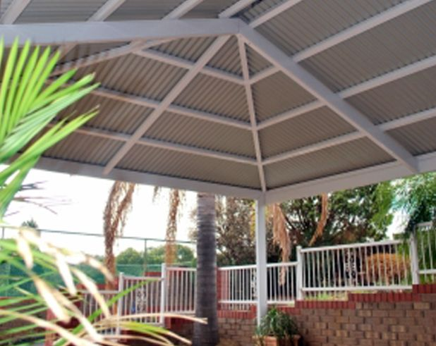 Metal roofed pergola verandahs hipped roof the colourco for Metal hip roof
