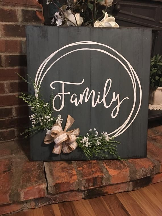 Photo of Hand-painted family sign with hand-drawn wreath, burlap and lace bow, leaves, baby's breath. Distressed, weathered, great gift
